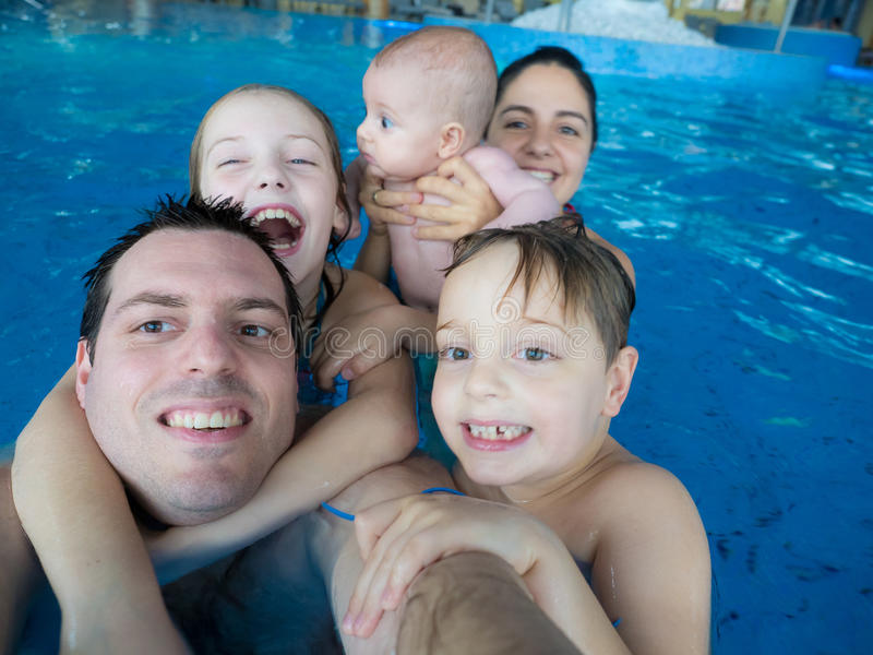Happy family in pool royalty free stock photos