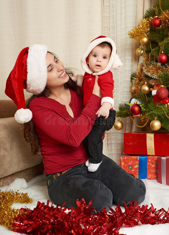 Happy family portrait in christmas decoration, winter holiday concept, decorated fir tree and gifts stock photography