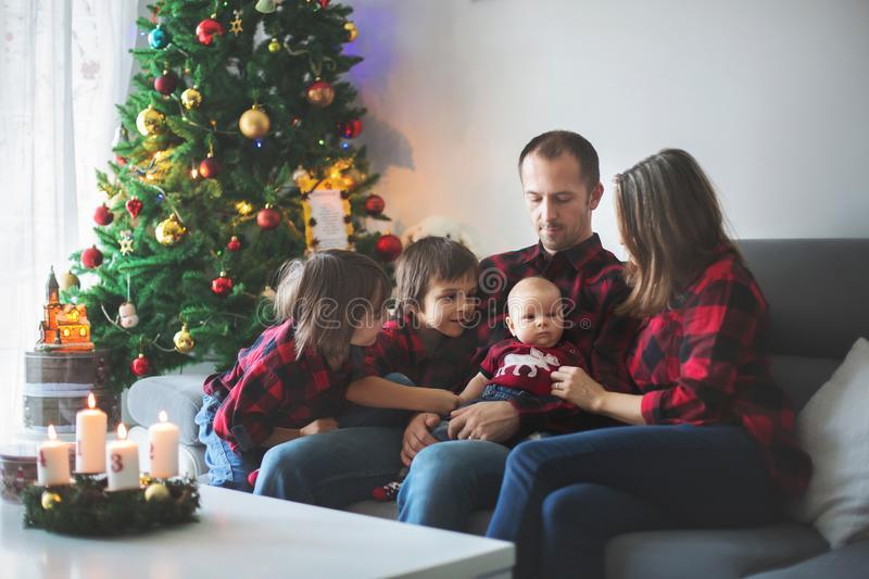 Happy family portrait on Christmas, mother, father and three chi stock image