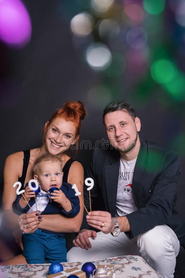 Happy family portrait with a little boy andin the studio for the new year. stock photo