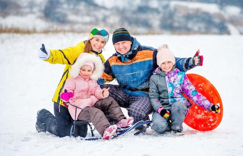 Happy family portrait outdoors at winter time royalty free stock photos
