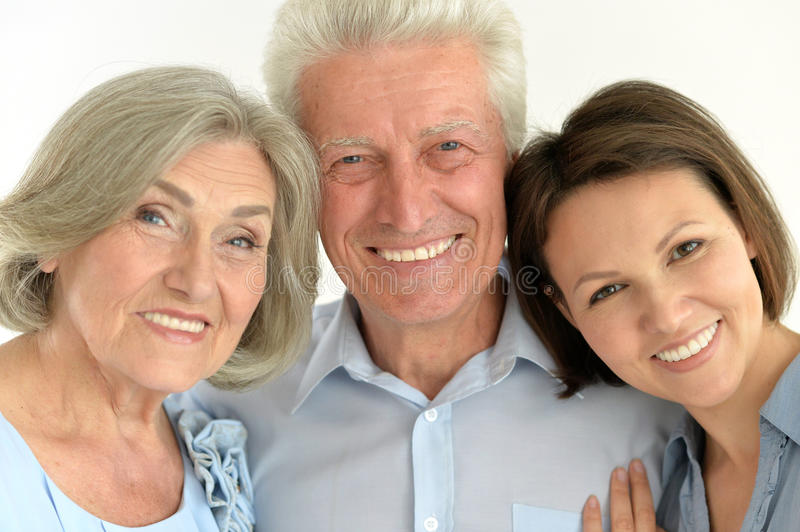Happy family portrait. Parents with adult daughter, close up stock images
