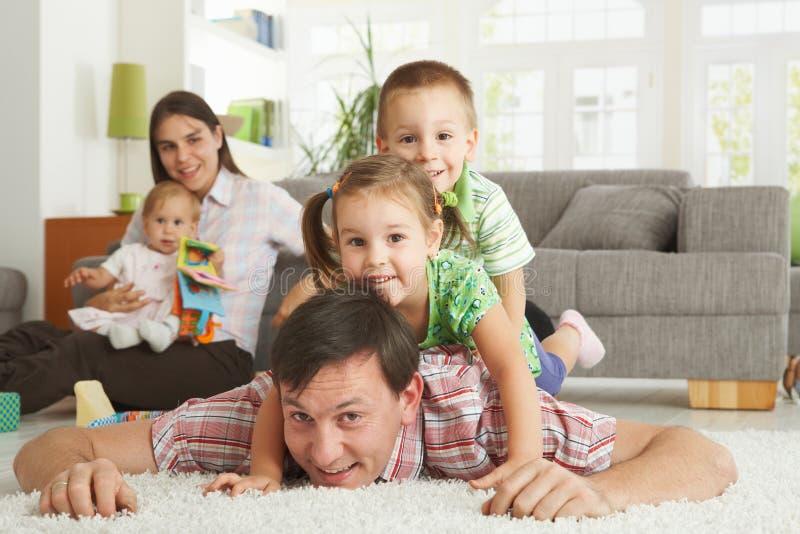 Happy family posing for camera stock photos