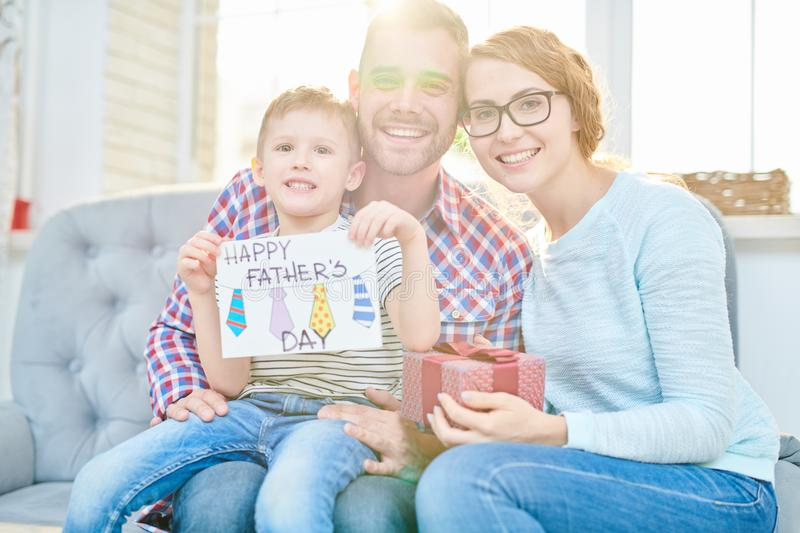 Happy Family Posing on Fathers Day in Sunlight stock images