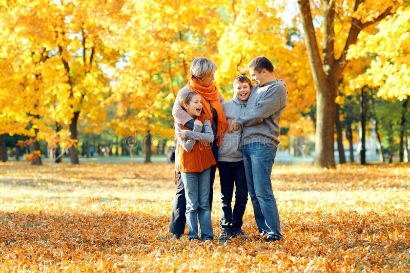 Happy family posing, playing and having fun in autumn city park. Children and parents together having a nice day. Bright sunlight royalty free stock photos