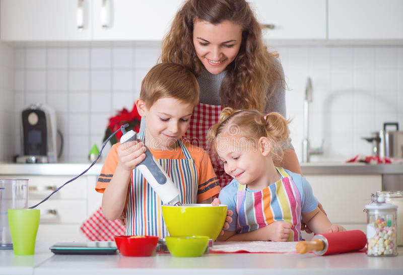 Happy family preparing cookies for Christmas eve stock photography