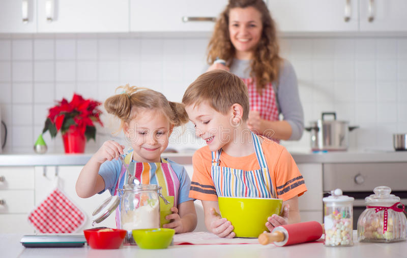Happy family preparing cookies for Christmas eve. At home royalty free stock photos