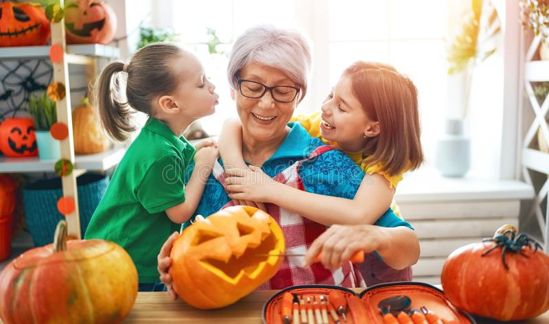 Family preparing for Halloween stock photos