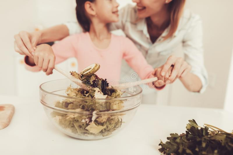 Happy Family Is Preparing A Salad At Kitchen. royalty free stock photography