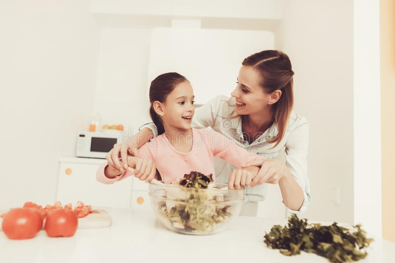 Happy Family Is Preparing A Salad At Kitchen. royalty free stock photo