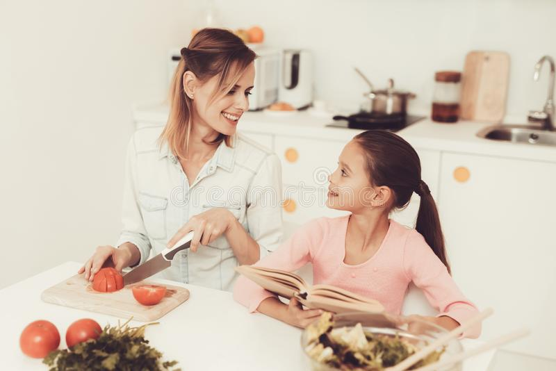 Happy Family Is Preparing A Salad At Kitchen. stock photos