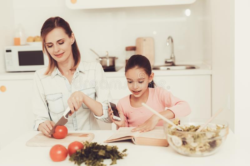 Happy Family Is Preparing A Salad At Kitchen. royalty free stock photos