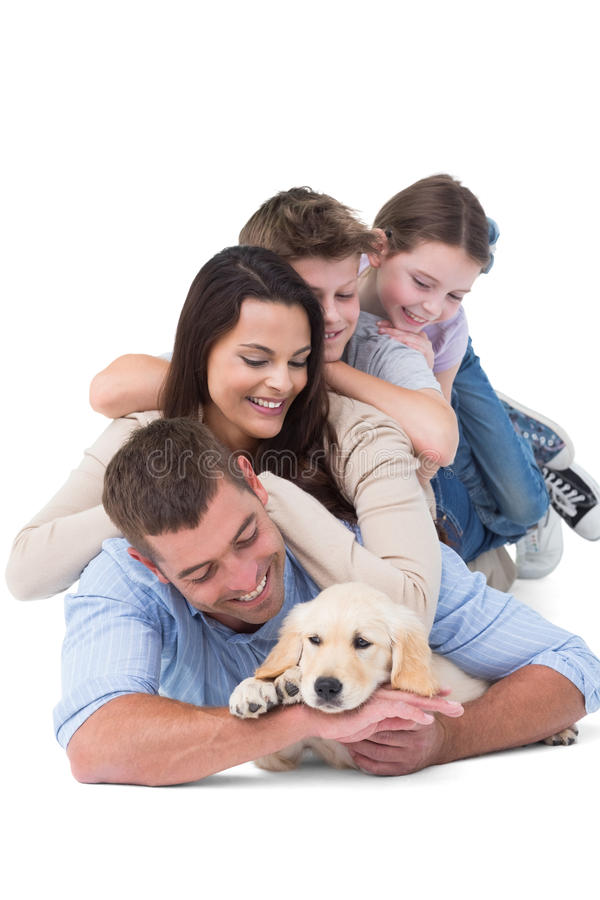 Happy family with puppy stock photos