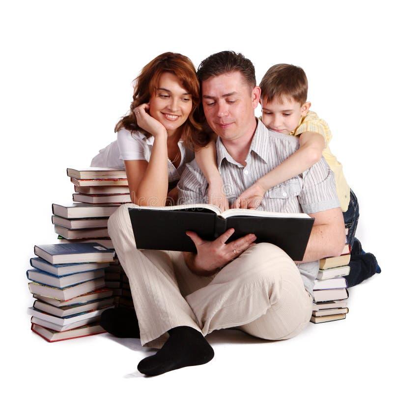 Happy Family reading books stock photo