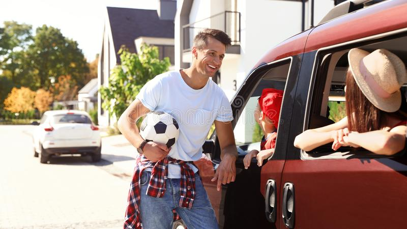Happy family ready to travel by car royalty free stock photography