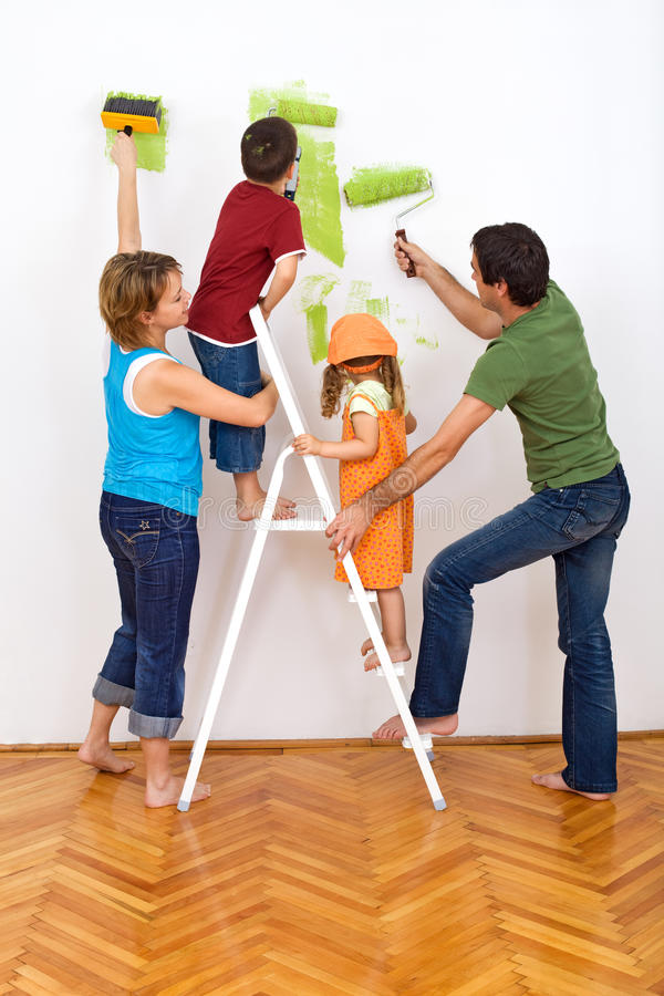 Happy Family Redecorating The House - Painting Stock Photo - Image ...