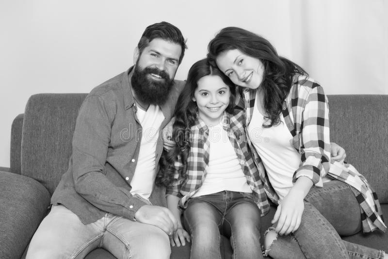Happy family relax at home. family weekend. mother and father love daughter. little girl with parents. trust and bonds. Bearded men and women with child stock photo