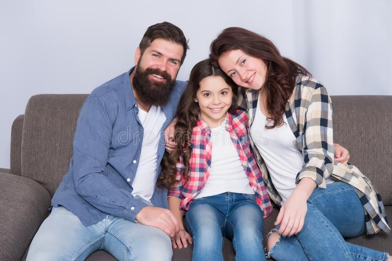 Happy family relax at home. family weekend. mother and father love daughter. little girl with parents. trust and bonds. Bearded men and women with child royalty free stock photo