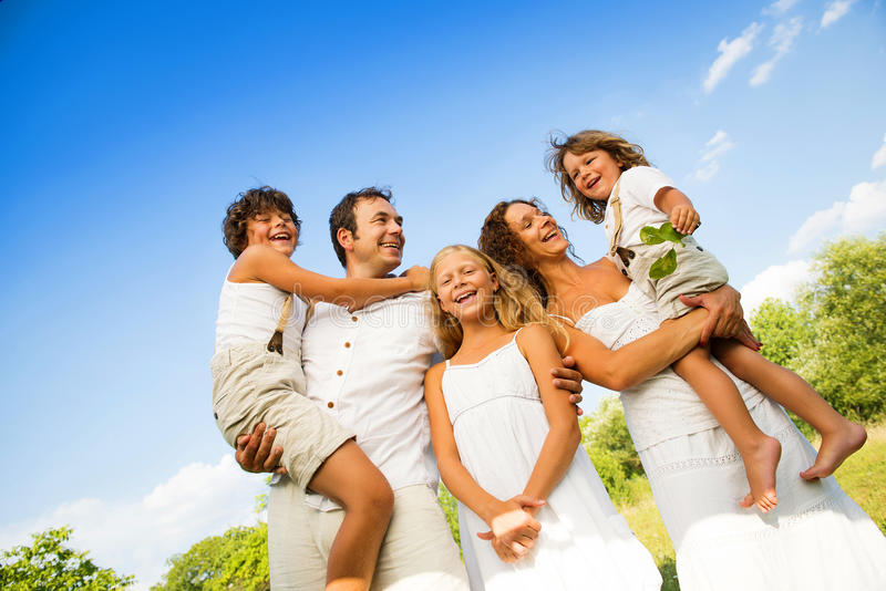 Happy family. Relaxing in green nature together royalty free stock photography