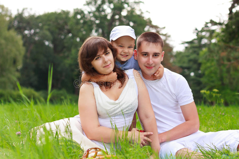 Happy family relaxing outdoor royalty free stock photography