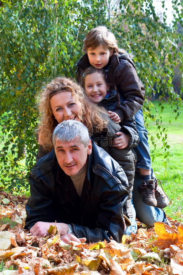 Happy Family Relaxing Outdoors In Autumn stock image
