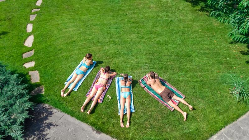 Happy family relaxing by swimming pool, aerial drone view from above of parents and kids have fun on vacation, family weekend stock photography