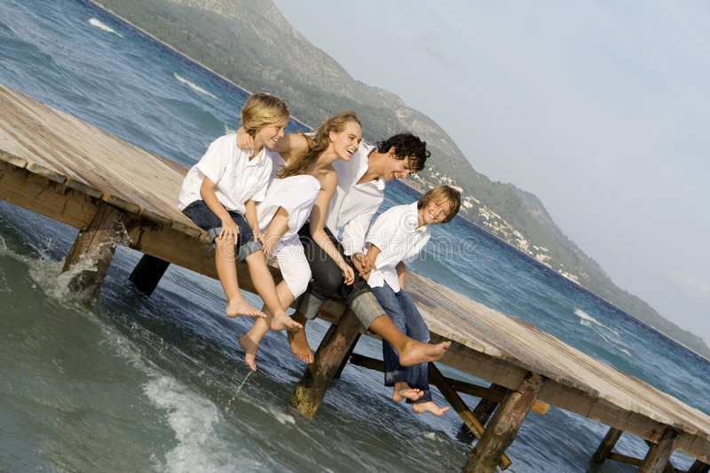 Happy family relaxing on vacation stock images