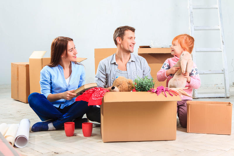The happy family at repair and relocation royalty free stock photos