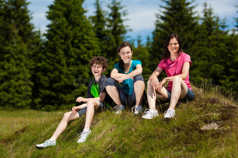 Happy family resting outdoor royalty free stock photography