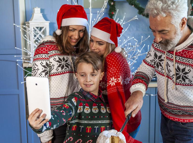 Happy family reunited on Christmas day taking a selfie stock images
