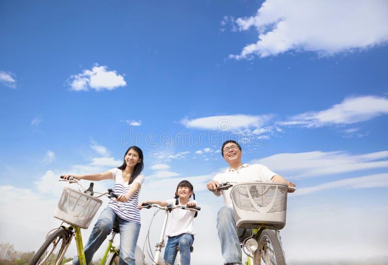 Happy family riding bicycle stock photo