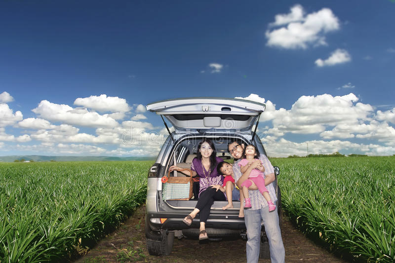 Happy Family on a road trip. Happy Asian family posing on a road trip in Australia