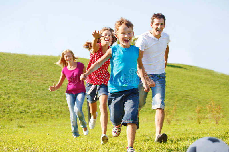 Happy family running stock image