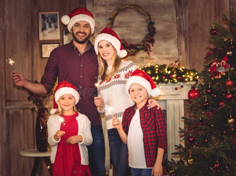 Happy family in santa hats royalty free stock image
