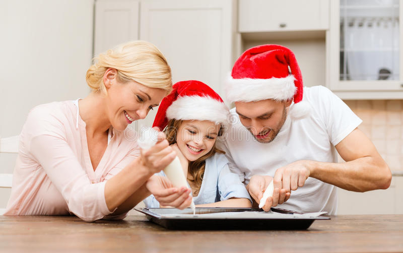 Download Happy Family In Santa Helper Hats Making Cookies Stock Photo - Image: 35224532