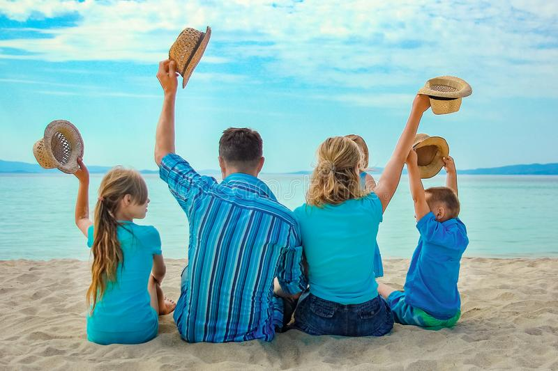 Happy family at sea in greece on nature background royalty free stock images