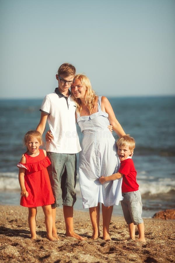 Happy family at the sea stock image
