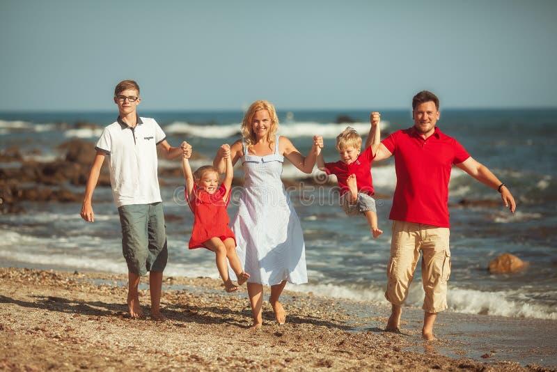 Happy family at the sea royalty free stock photo