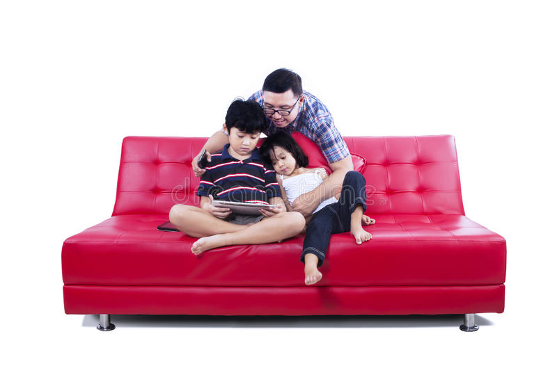 Download Happy Family Seated On A Couch Isolated Stock Photo - Image: 32327152