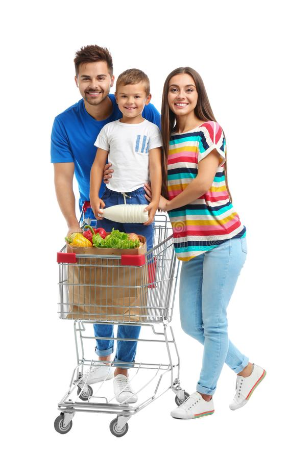 Happy family with shopping cart on background. Happy family with shopping cart on white background royalty free stock photo