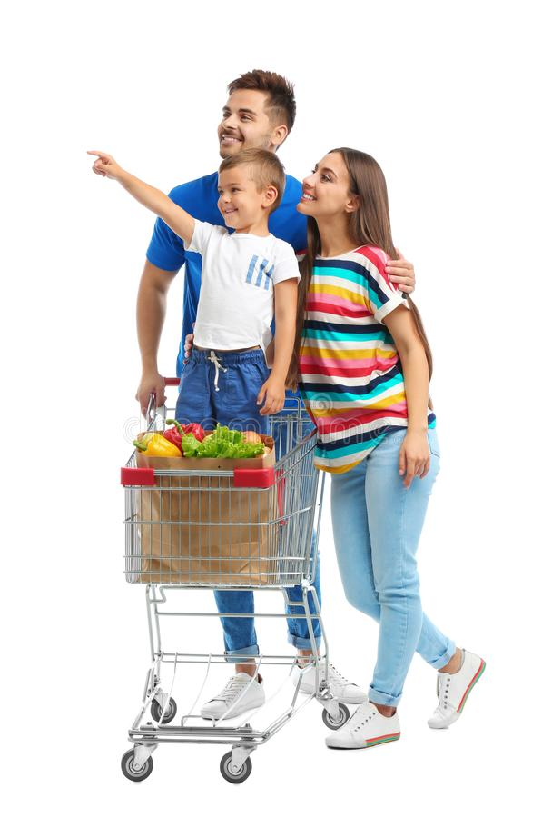 Happy family with shopping cart on background. Happy family with shopping cart on white background royalty free stock image