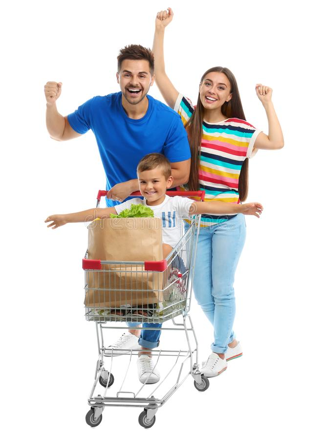 Happy family with shopping cart on background. Happy family with shopping cart on white background stock photos