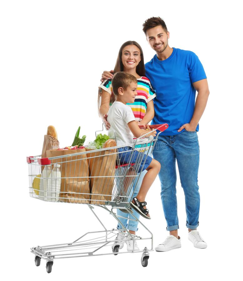 Happy family with shopping cart on background. Happy family with shopping cart on white background stock images
