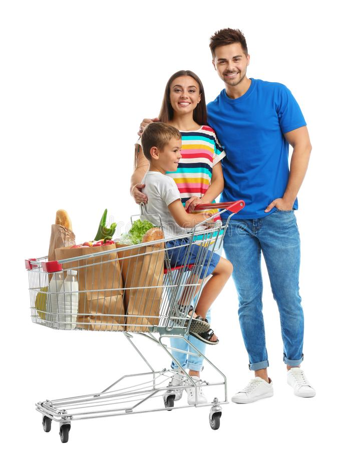 Happy family with shopping cart on background. Happy family with shopping cart on white background royalty free stock photography