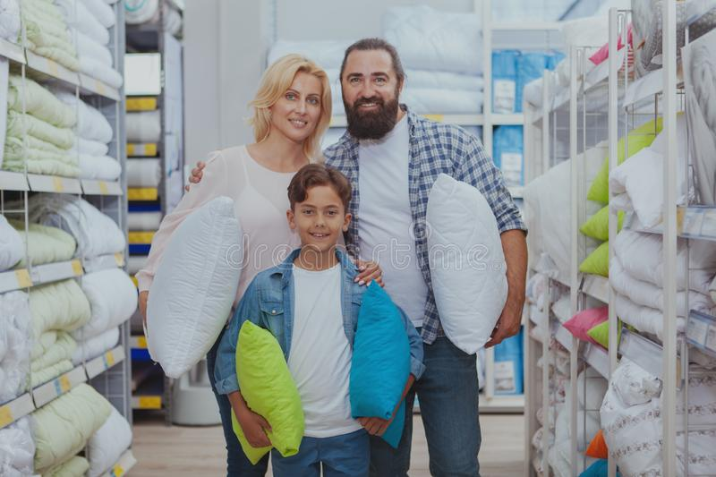 Happy family shopping at furniture store royalty free stock photo
