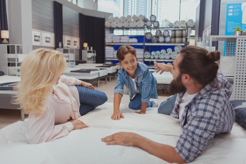 Happy family shopping at furniture store stock photography