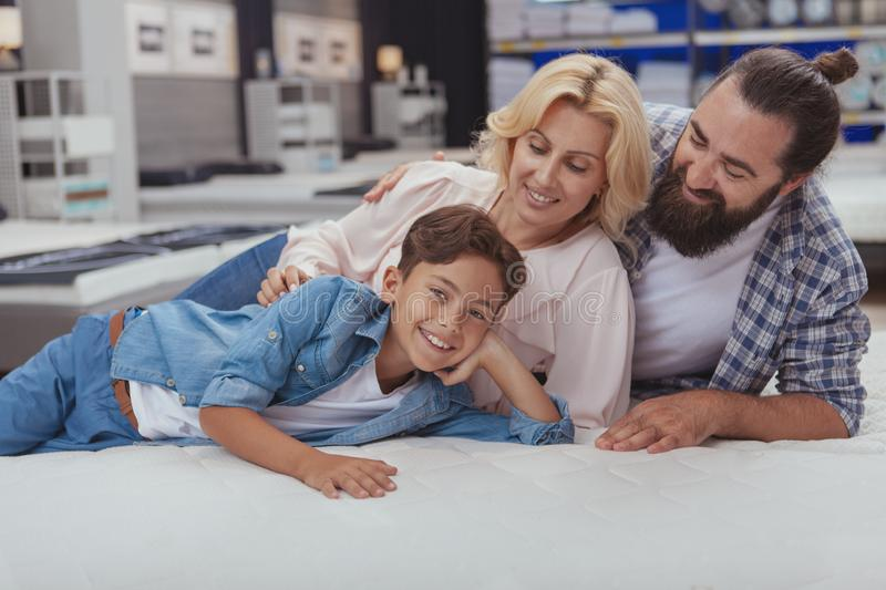 Happy family shopping at furniture store royalty free stock image