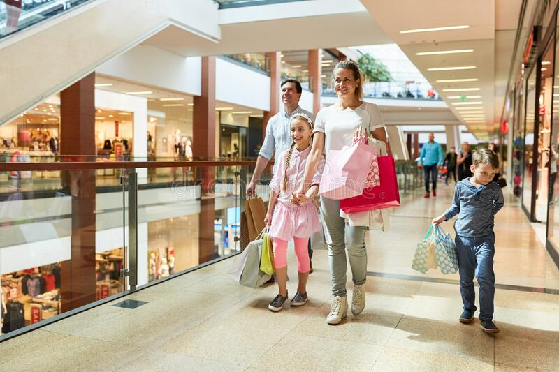 Happy family shopping. With many shopping bags in shopping mall stock photography