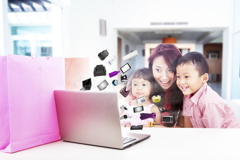 Happy family shopping online stock image