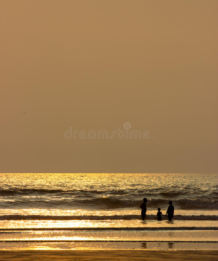 Happy family silhouette on beach royalty free stock photos